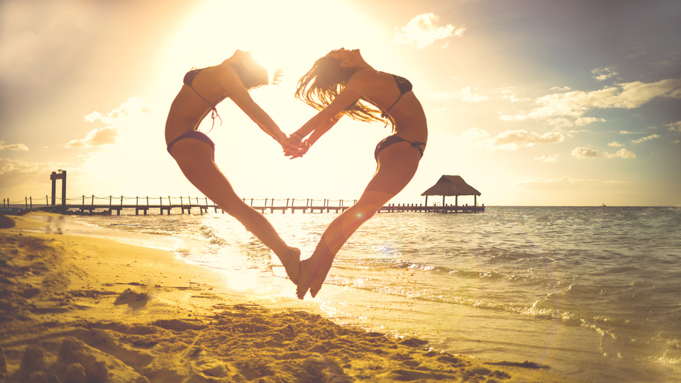 rsz_gilrs_on_beach_jumping_to_make_cute_love_heart_stokpic2